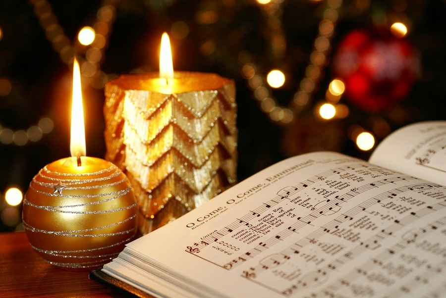 Detail of songbook with Christmas carols and Christmas decorations.